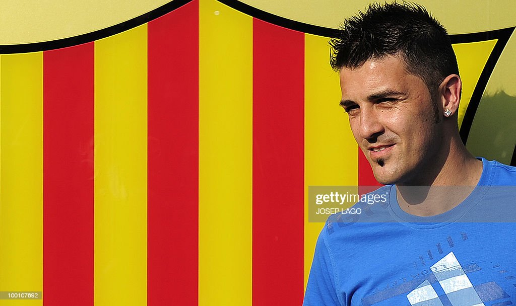 Barcelona's new signing David Villa poses outside of the Nou Camp stadium in Barcelona after agreeing to terms with the Catalan club in Barcelona on May 20, 2010.