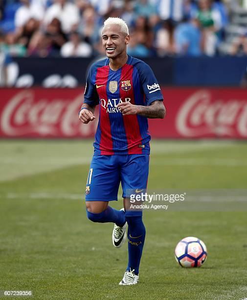 Barcelona's Neymar JR celebrates after scoring a goal during the Spanish La Liga soccer match between FC Barcelona and Leganes at Butarque Stadium on...