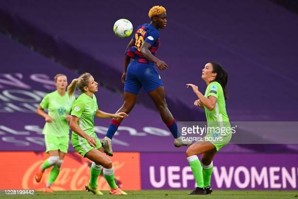 Barcelona's Nigerian forward Asisat Oshoala jumps for the ball during the UEFA Women's Champions League semi-final football match between VFL...