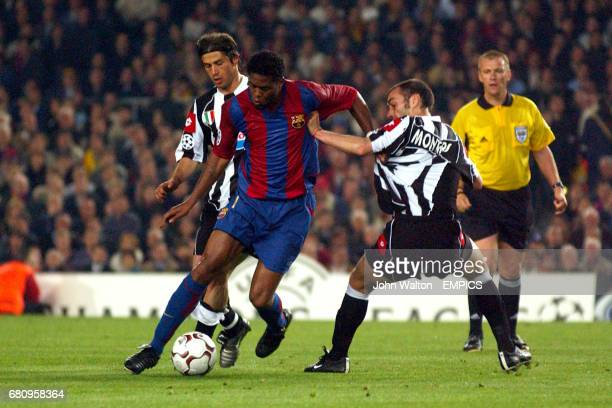 Barcelona's Patrick Kluivert holds off Juventus' Paolo Montero