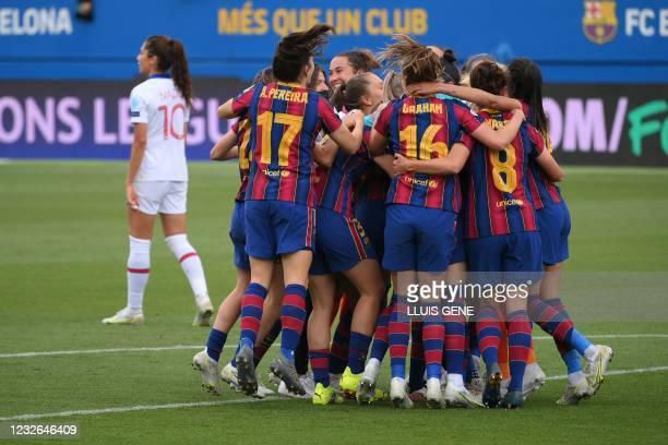 Barcelona´s player celebrate after winning the UEFA Women's Champions League second leg semi-final football match against Paris Saint-Germain at the...