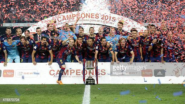 Barcelona's players and pose with the Copa del Rey trophy after winning the Copa del Rey Final between Athletic Club and FC Barcelona at Camp Nou on...