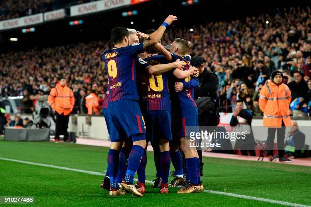 Barcelona's players celebrate a goal during the Spanish 'Copa del Rey' quarterfinal second leg football match between FC Barcelona and RCD Espanyol...