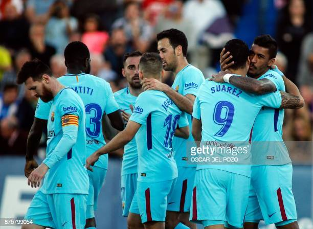 Barcelona's players celebrate a goal during the Spanish league football match Leganes vs Barcelona at the Butarque stadium in Leganes on November 18...