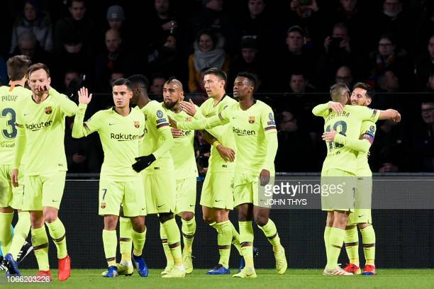Barcelona's players celebrate after Barcelona's Argentine forward Lionel Messi scored a goal during the UEFA Champions League football match between...