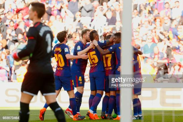 Barcelona´s players celebrate after Barcelona's Spanish forward Paco Alcacer scored during the Spanish League football match between FC Barcelona and...