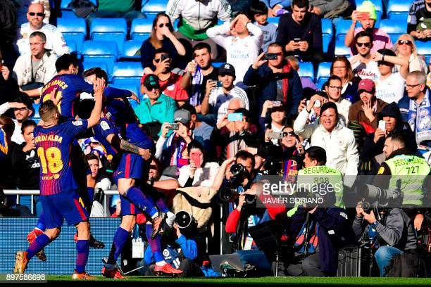 Barcelona's players celebrate after Barcelona's Spanish midfielder Aleix Vidal scored a goal during the Spanish League 'Clasico' football match Real...