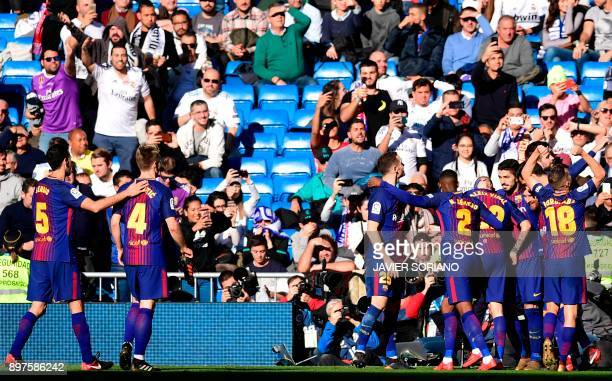 Barcelona's players celebrate after Barcelona's Spanish midfielder Aleix Vidal scored during the Spanish League 'Clasico' football match Real Madrid...