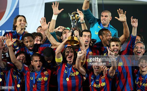 Barcelona's players celebrate after beating Argentina's Estudiantes de La Plata to win the 2009 FIFA Club World Cup at Zayed Sports City Stadium in...