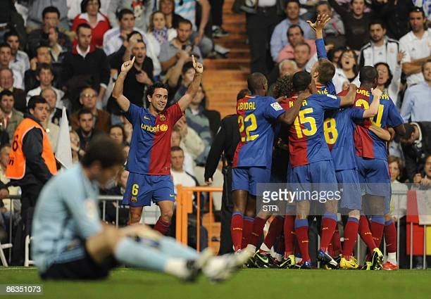 Barcelona's players celebrate after defeating Real Madrid in front of Real Madrid goalkeeper Iker Casillas during a Spanish league football match at...