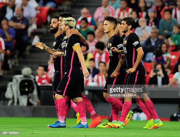 Barcelona's players celebrate after scoring the opener during the Spanish league football match Athletic Club Bilbao vs FC Barcelona at the San Mames...