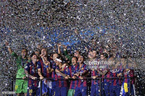 Barcelona's players celebrate after the UEFA Champions League Final football match between Juventus and FC Barcelona at the Olympic Stadium in Berlin...