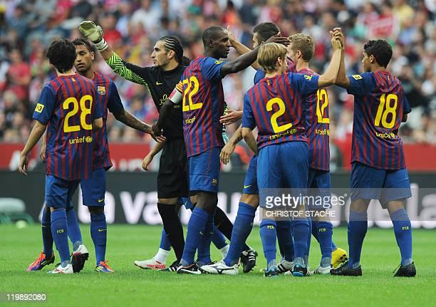 Barcelona's players celebrate after their Audi Cup football match FC Barcelona vs SC International de Porto Alegre in Munich southern Germany on July...