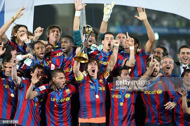 Barcelona's players celebrate after winning the 2009 FIFA Club World Cup at Zayed Sports City Stadium in Abu Dhabi on December 19 2009 Barcelona beat...