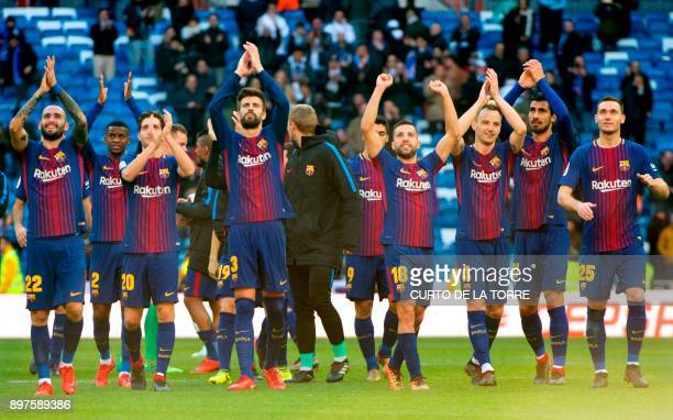 Barcelona's players celebrate at the end of the Spanish League 'Clasico' football match Real Madrid CF vs FC Barcelona at the Santiago Bernabeu...