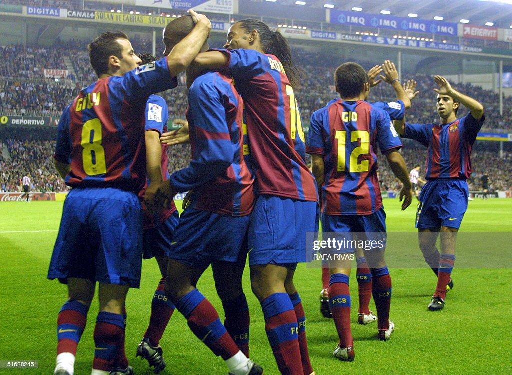 Barcelona's players celebrate Cameroonian Samuel Eto'o's