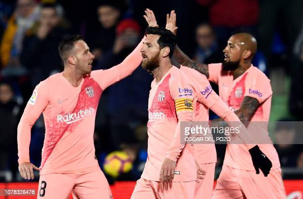 Barcelona's players celebrate their opening goal scored by Barcelona's Argentinian forward Lionel Messi during the Spanish League football match...