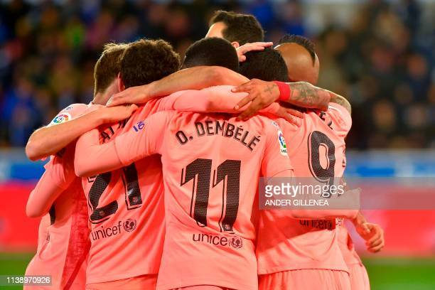TOPSHOT Barcelona's players celebrate their second goal during the Spanish league football match between Deportivo Alaves and FC Barcelona at the...