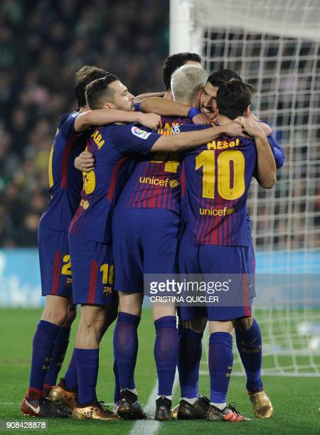 Barcelona's players celebrate their second goal during the Spanish league football match between Real Betis and FC Barcelona at the Benito Villamarin...