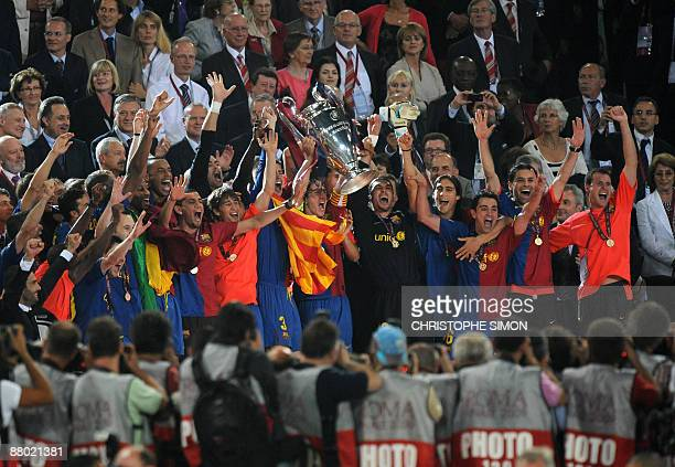 FC Barcelona's players celebrate with the Champions League Cup during the trophy ceremony on May 27 2009 at the Olympic Stadium in Rome Barcelona...