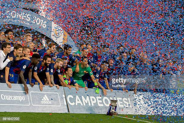 Barcelona's players cellebrating the victory of the Spanish Super Cup football match between FC Barcelona and Sevilla FC at Camp Nou Stadium on...