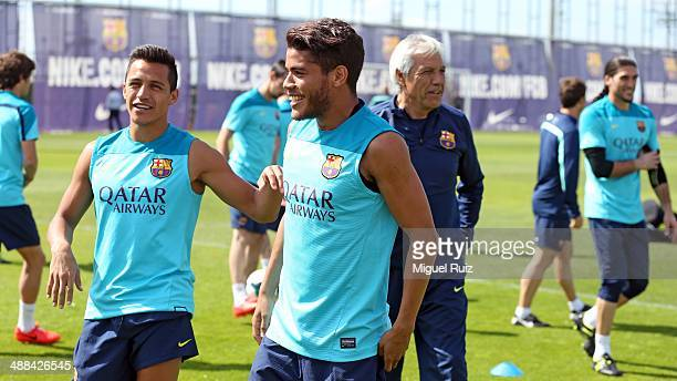 Barcelona's players joke with his teammate Jonathan dos Santos during the training session at Ciutat Esportiva on May 6 2014 in Barcelona Spain