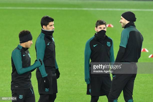 Barcelona's players Lionel Messi Neymar Luis Suarez and Gerard Pique attend a training session at the Parc des Princes on the eve of the UEFA...