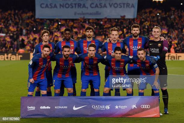 Barcelona's players midfielder Sergi Roberto French defender Samuel Umtiti Portuguese midfielder Andre Gomes Croatian midfielder Ivan Rakitic...