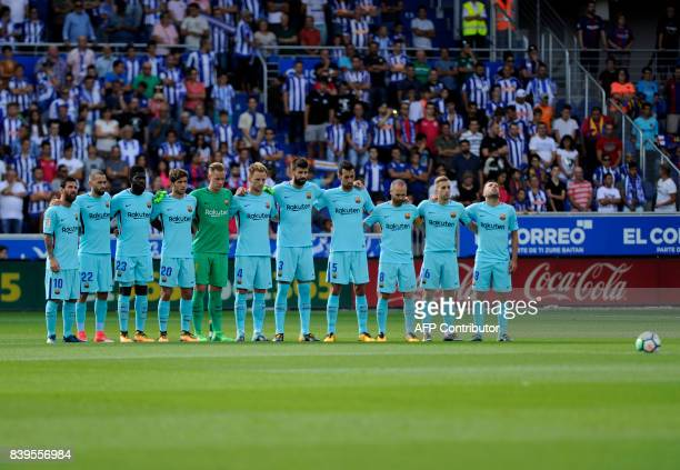 Barcelona's players observe a minute of silence for the victims of the attacks in Barcelona and Cambrils before the Spanish league football match...
