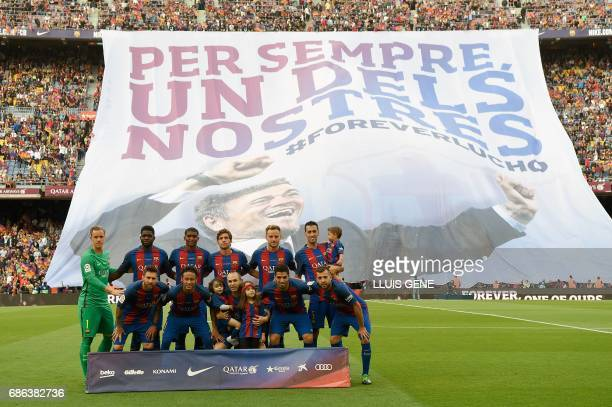 Barcelona's players pose before during the Spanish league football match FC Barcelona vs SD Eibar at the Camp Nou stadium in Barcelona on May 21 2017...