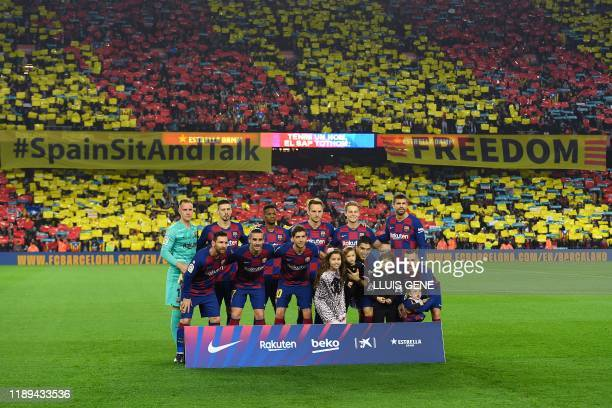Barcelona's players pose before the El Clasico Spanish League football match between Barcelona FC and Real Madrid CF at the Camp Nou Stadium in...