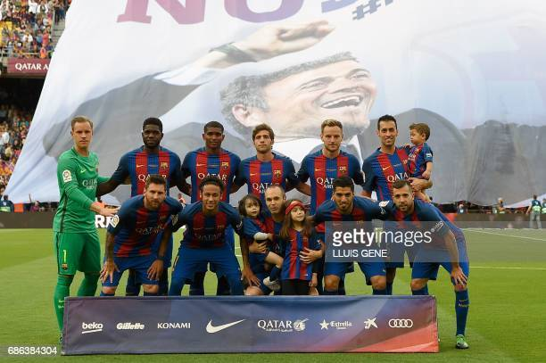 Barcelona's players pose before the Spanish league football match FC Barcelona vs SD Eibar at the Camp Nou stadium in Barcelona on May 21 2017 / AFP...