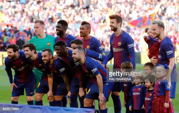 Barcelona's players pose before the Spanish League football match between FC Barcelona and Athletic Club Bilbao at the Camp Nou stadium in Barcelona...