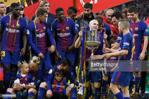 Barcelona's players pose with the trophy after winning the Spanish Copa del Rey final football match Sevilla FC against FC Barcelona at the Wanda...