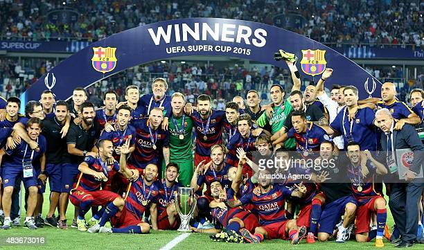 Barcelona's players pose with the UEFA Cup trophy after victory in the UEFA Super Cup between Barcelona and Sevilla FC at Dinamo Arena on August 11...