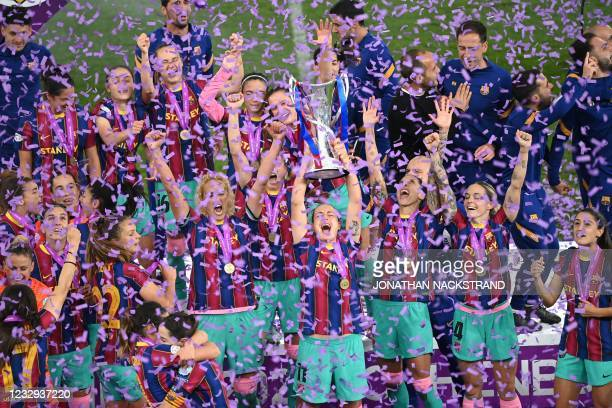 Barcelona's players raise their trophy after winning the UEFA Women's Champions League final between Chelsea FC and FC Barcelona in Gothenburg,...