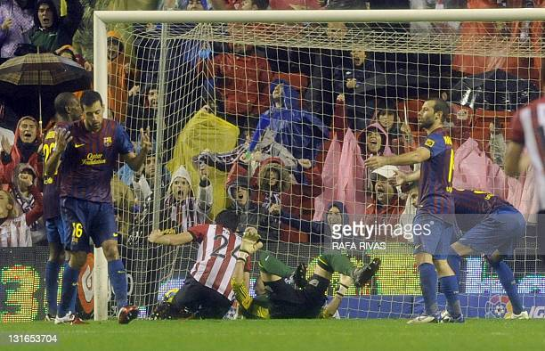 Barcelona's players react as Athletic score their second goal during the Spanish league football match Athletic Bilbao vs Barcelona at San Mames...