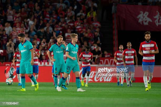 Barcelona's players react to Granada's Nigerian midfielder Ramon Azeez' goal during the Spanish league football match between Granada FC and FC...
