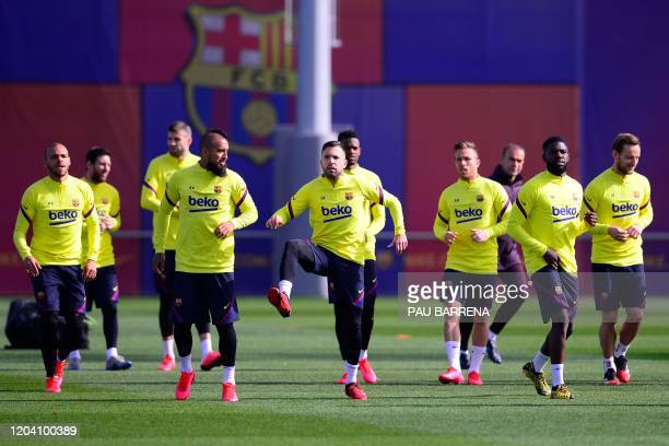 Barcelona's players take part in a training session at the Joan Gamper training ground in Sant Joan Despi in the outskirts of Barcelona on February...