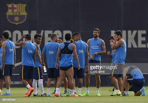 Barcelona's players take part in a training session at the Sports Center FC Barcelona Joan Gamper in Sant Joan Despi, near Barcelona on July 31,...