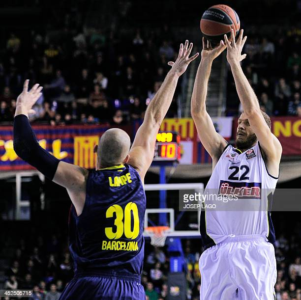 Barcelona's Polish center Maciej Lampe vies with Fenerbahce Ulker's Croatian center Luka Zoric during the Euroleague basketball match FC Barcelona vs...