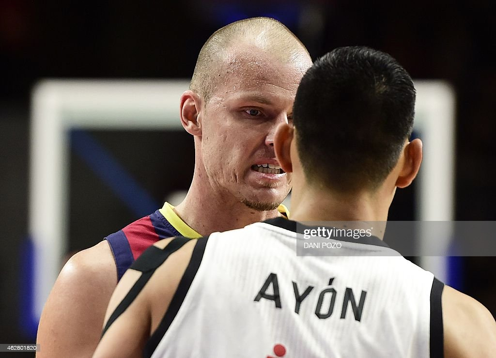 Barcelonau0027s Polish Centre Maciej Lampe (C) Argues With Real Madridu0027s  Mexican Centre Gustavo Ayon During The Euroleague Basketball Top 16 Round 6  Match Real ...
