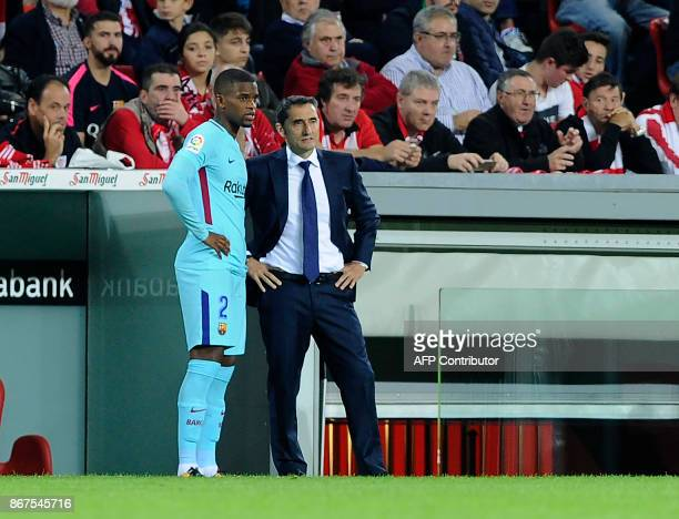 Barcelona's Portuguese defender Nelson Semedo and Barcelona's Spanish coach Ernesto Valverde stand on the sideline during the Spanish league football...