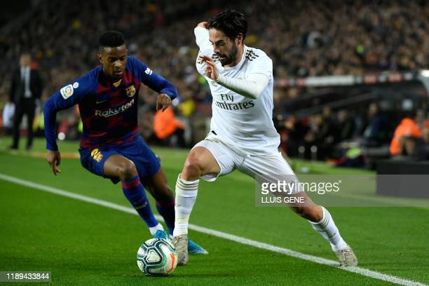 """Barcelona's Portuguese defender Nelson Semedo challenges Real Madrid's Spanish midfielder Isco during the """"El Clasico"""" Spanish League football match..."""