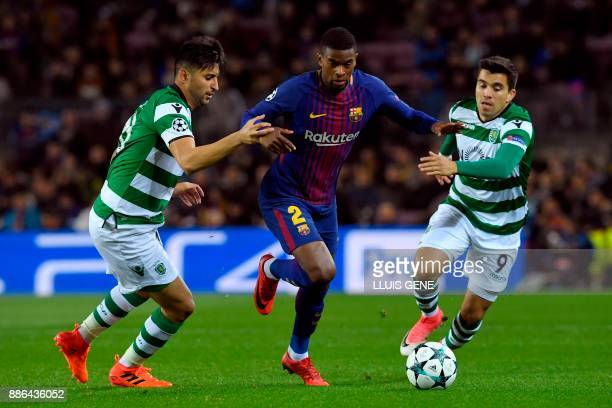 Barcelona's Portuguese defender Nelson Semedo challenges Sporting's Argentinian forward Marcos Acuna and Sporting's Argentinian forward Alan Ruiz...