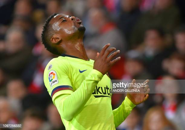 Barcelona's Portuguese defender Nelson Semedo gestures during the Spanish league football match Athletic Club Bilbao against FC Barcelona at the San...