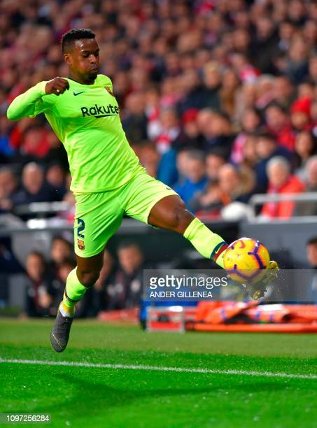 Barcelona's Portuguese defender Nelson Semedo runs with the ball during the Spanish league football match Athletic Club Bilbao against FC Barcelona...
