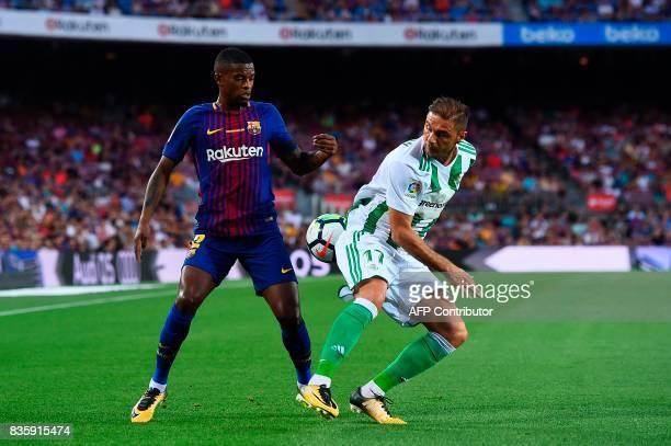 Barcelona's Portuguese defender Nelson Semedo vies with Betis' midfielder Joaquin during the Spanish league footbal match FC Barcelona vs Real Betis...