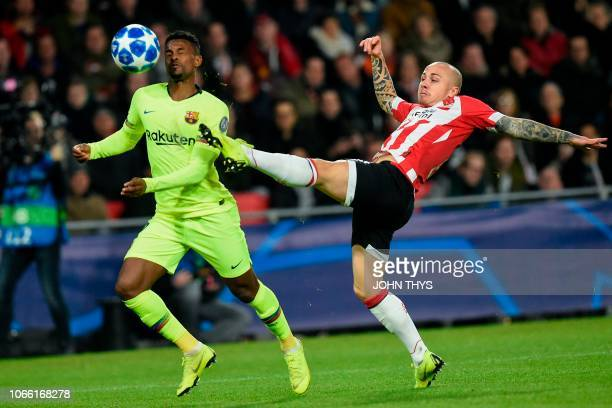 Barcelona's Portuguese defender Nelson Semedo vies with Eindhoven's defender Angelino during the UEFA Champions League football match between PSV...