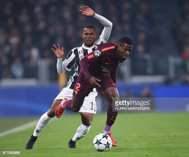 Barcelona's Portuguese defender Nelson Semedo vies with Juventus' forward from Brazil Douglas Costa during the UEFA Champions League Group D football...